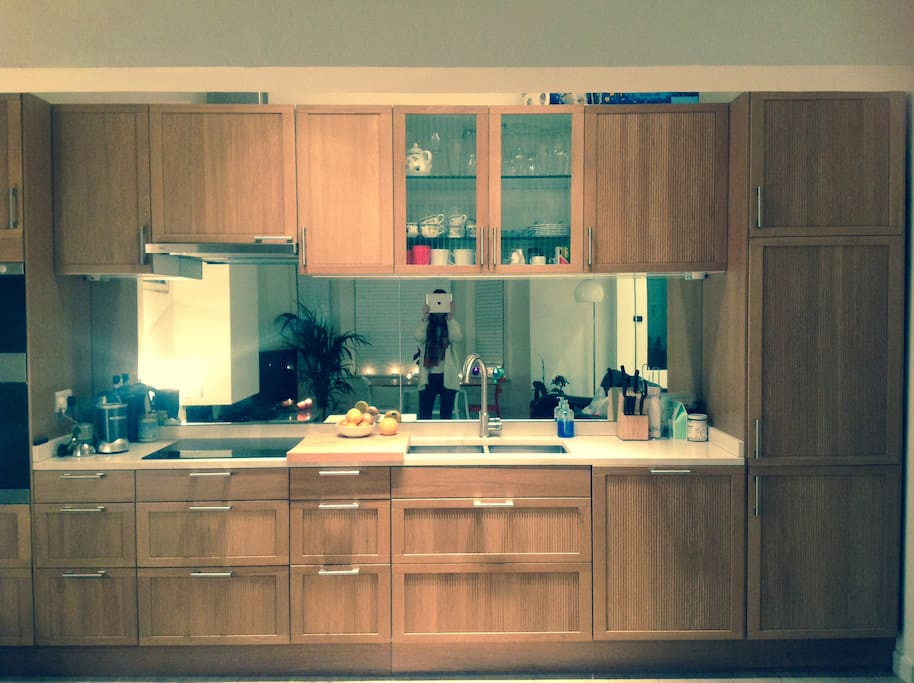 Brand new fully equipped kitchen with induction cooker, oven and microwave.