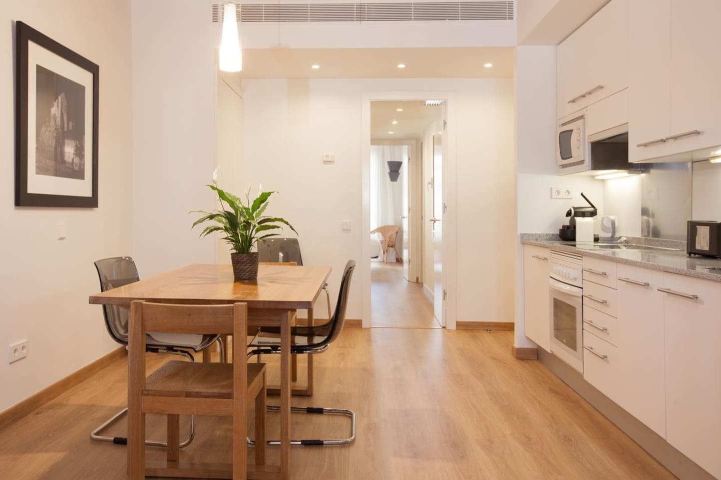 Dining table facing the open straight kitchen