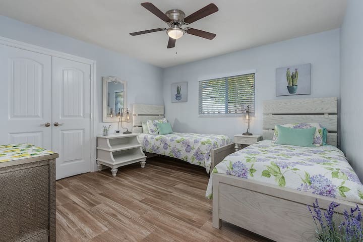 """""""Lavender"""" Guest bedroom features 2 twin beds."""
