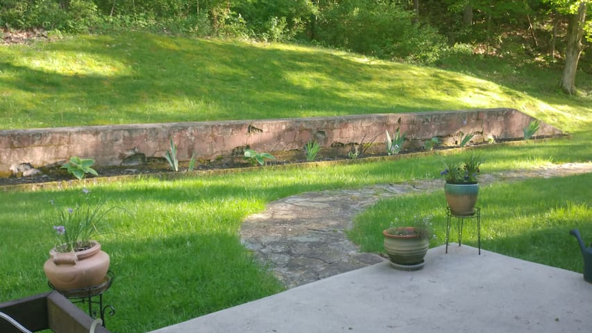 Enjoy lots of outdoor spaces -- even a stream you can hear from this patio.