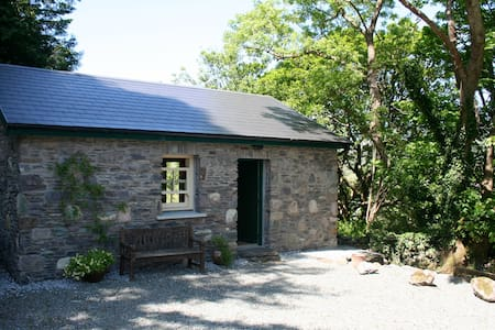 Bothy in scenic mountain valley