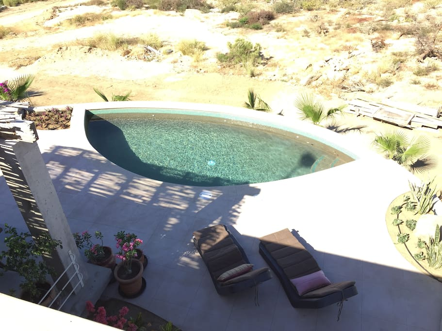 view of pool & patio from above