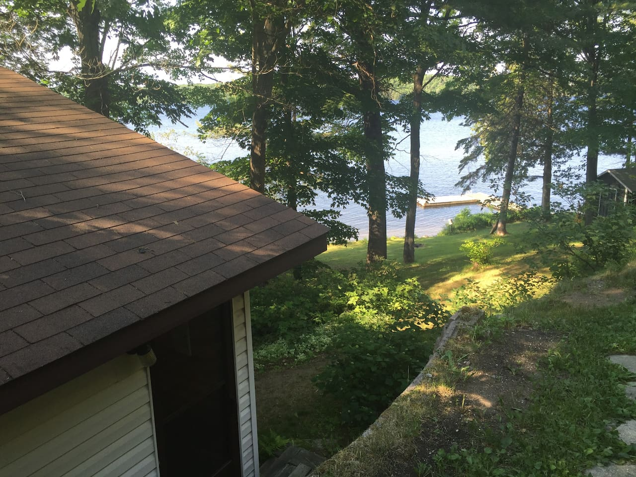 Here is a view of your cabin in the foreground and our shared dock you can fish or swim from.