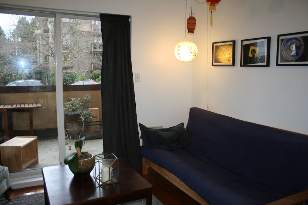 Futon in this photo has been replaced with a much more stylish and comfortable sofa bead for sleeping and sitting.