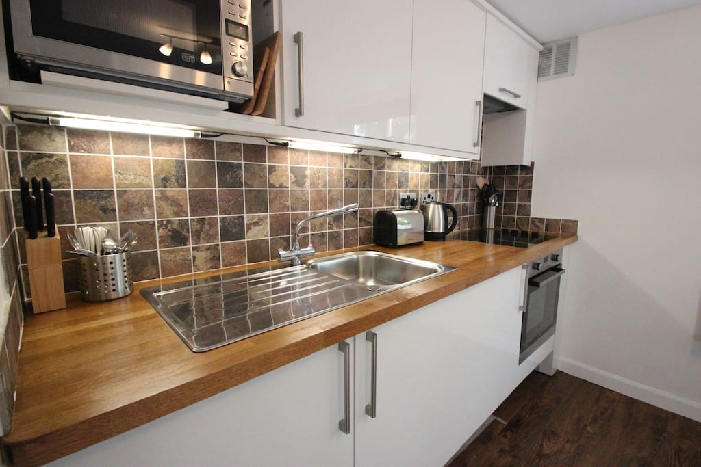 Fully fitted kitchen with built-in washer-dryer, fridge-freezer, microwave, oven & hob