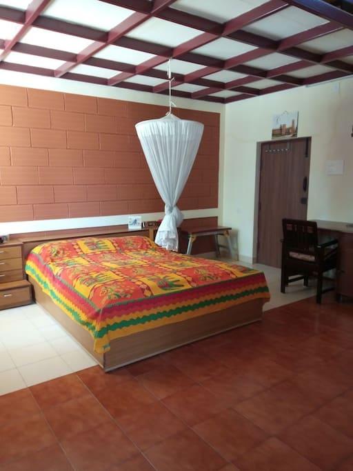 Queen bed, mosquito net and desk