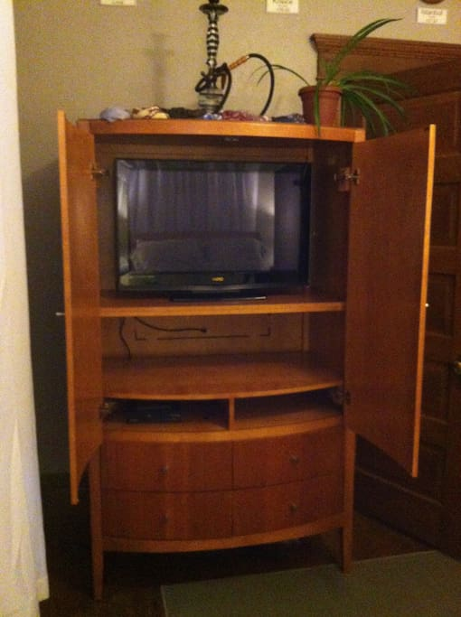 "32"" TV, DVD Player, Basic Cable and storage for your traveling items."