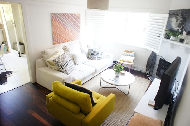 Gorgeous light filled living space with makassar timber floors
