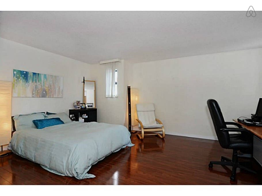 Large bedroom with office and connecting bathroom