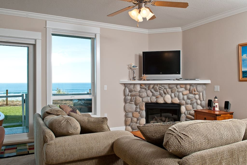 Relax In Comfortable Elegance With an HDTV and River Rock Fireplace