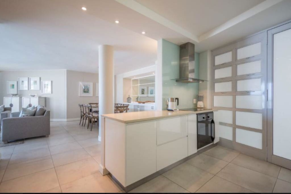 Open plan fresh and clean looking kitchen and dining room