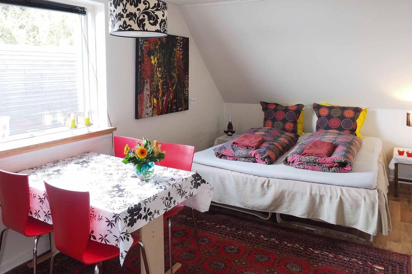 The big room in the flat with a double and a single bed. The double bed can be parted into two single beds.