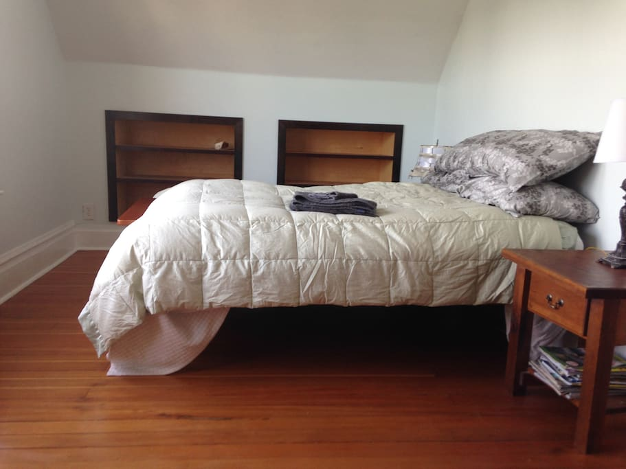 A photo of your room. Vintage fir floor, built in shelves to unpack into, and a comfortable bed looking out the window.