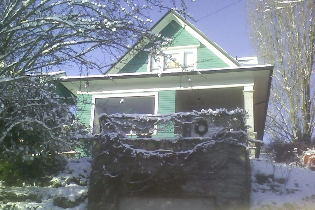 It is rare that it snows in Seattle, but this is a good shot of the front of our house. The window in your room is on top.