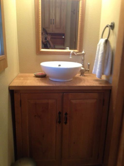 Vessel sink in 1/2 bath