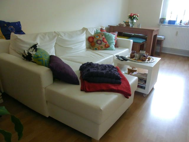 Living room, with a huge comfy couch and dinner table