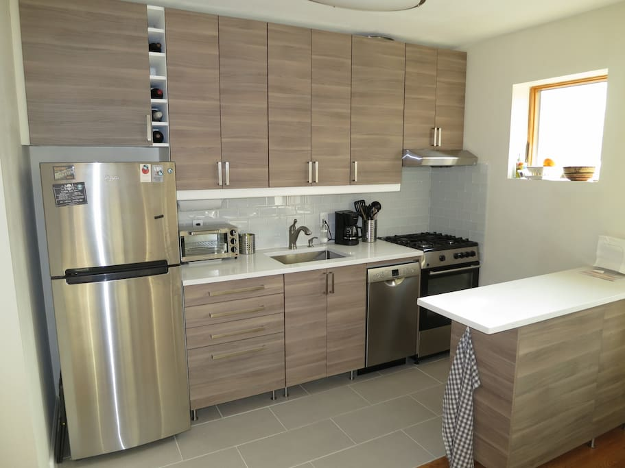 Brand new kitchen area with granite counters, dishwasher and 4-burner gas stove with oven. Renovated in 2017.
