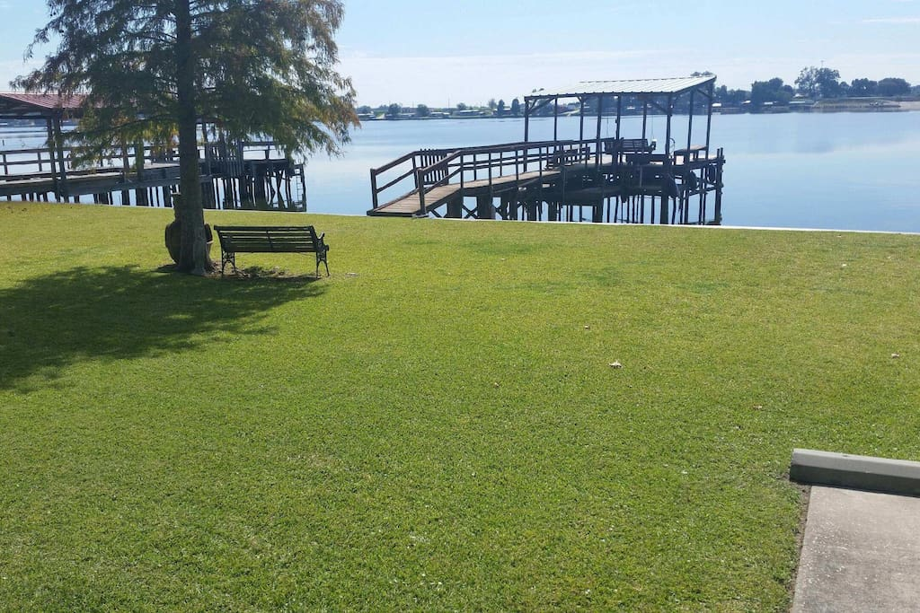 Beautiful green grass and private pier.