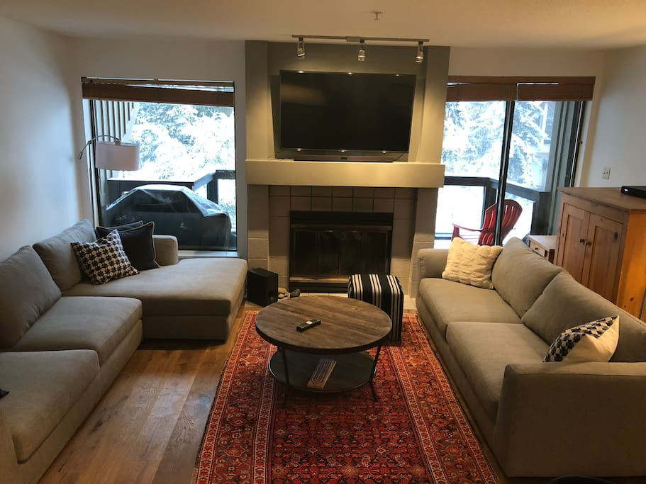New sofas, tv, coffee table, pillows, ottoman and blankets