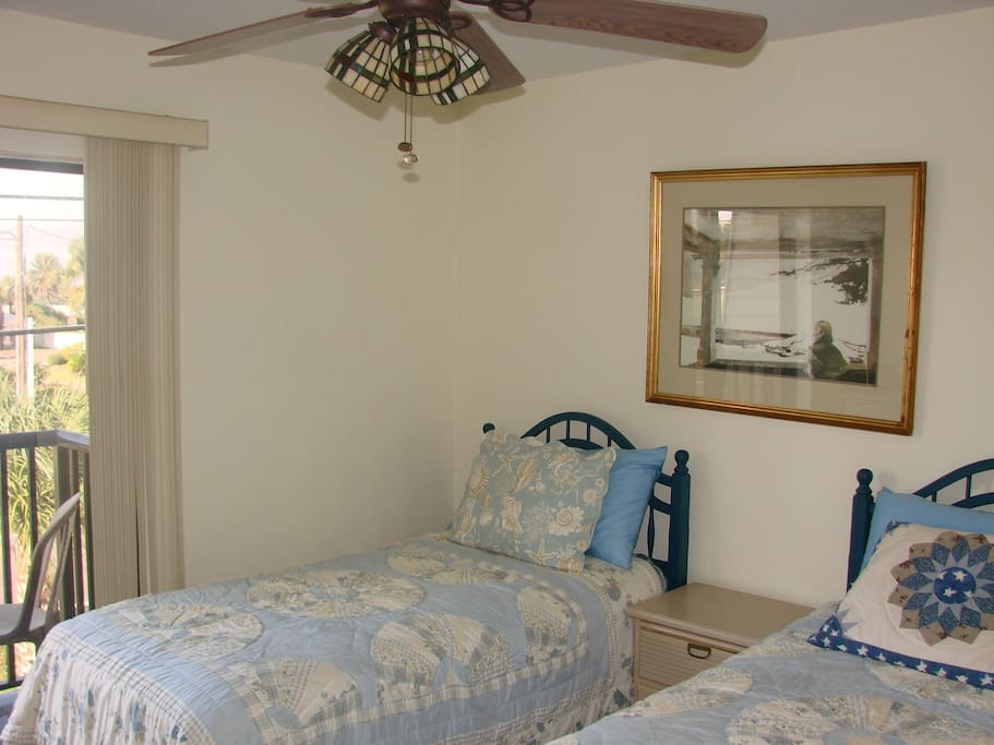 Bedroom 1 with 2 twin beds, master bath and river view