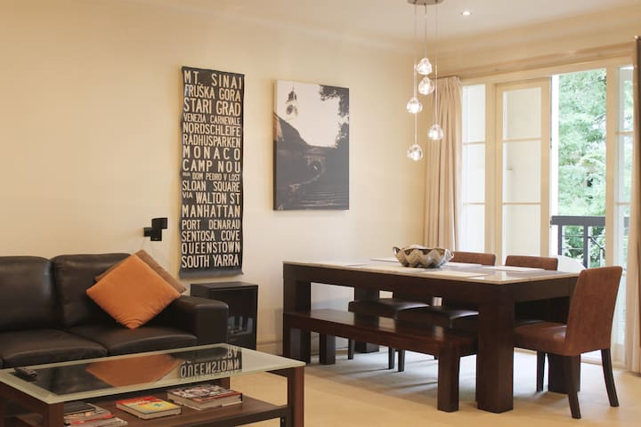 The apartment has so much natural light with easy access outside via the large French-doors to a private terrace overlooking the central courtyard for additional relaxation time. The large dining table makes it an ideal workspace and dining area.