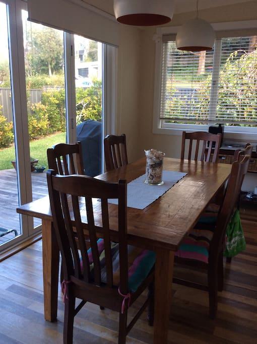 Dining area opens onto a rear deck creating a larger space via bi-folding doors.