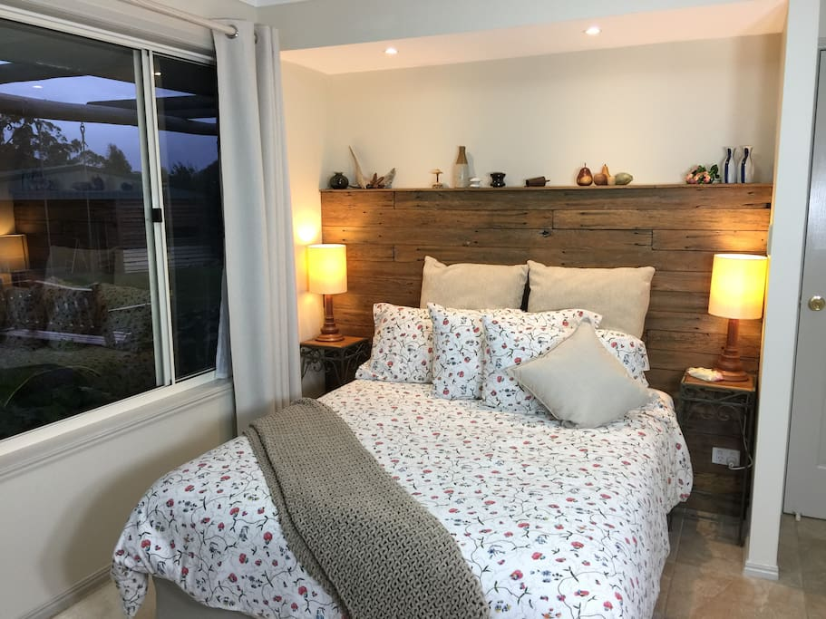 Comfortable double bed with views into the garden.