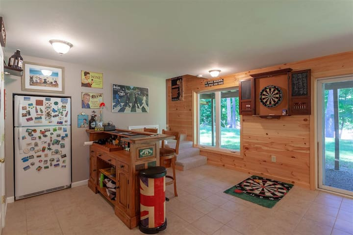 Lower level with walk-out to backyard and river