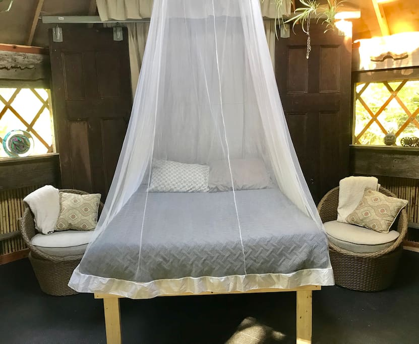 Our very comfortable, full-size Murphy bed with mosquito net!  We also have 2 cots and sleeping bags for additional accommodations.