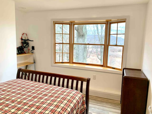 3rd bedroom with queen-size bed and bay window with seasonal views of the mountains