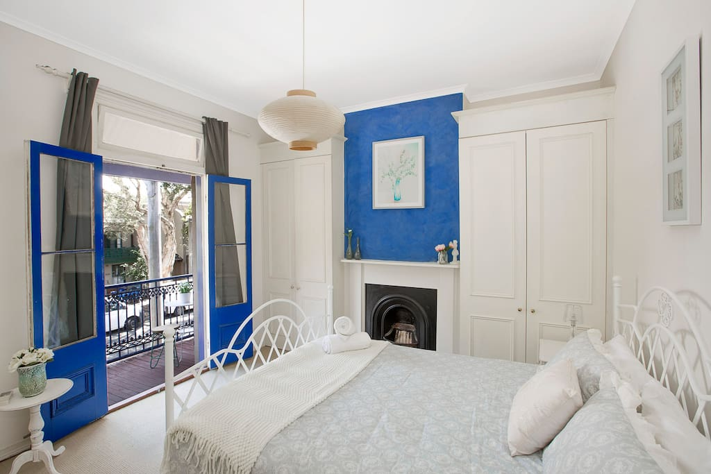 Large, Bright and Comfortable Main bedroom with feature wall, fireplace, A/C and private balcony