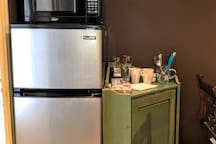 Fridge with freezer and microwave for quick meals.