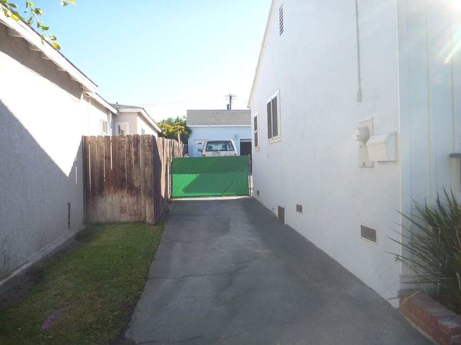 Driveway and Gate. That gate needs to be closed at all times since we have 2 friendly dogs in the shared yard.