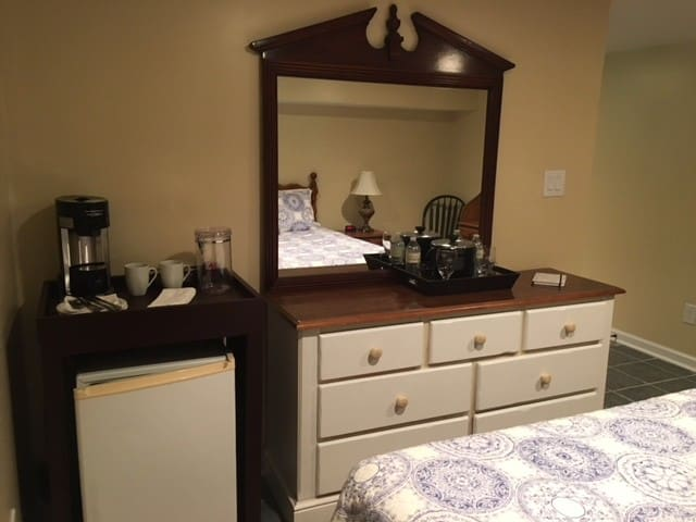 The coffee maker and fridge in Suite 5.