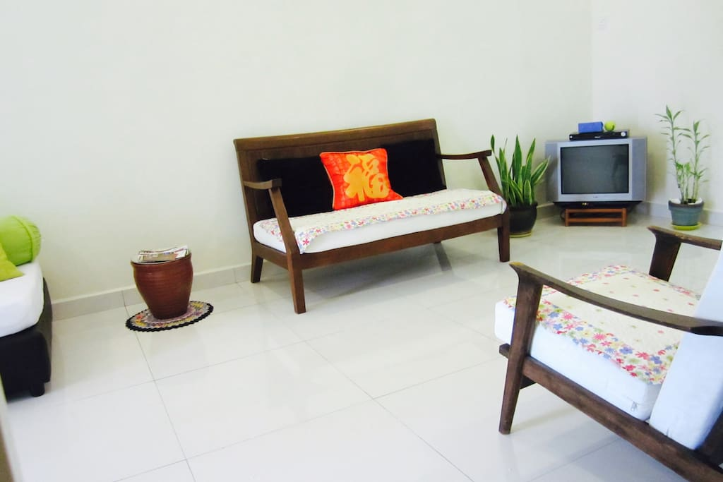 Living Area With Small Television And Video Player