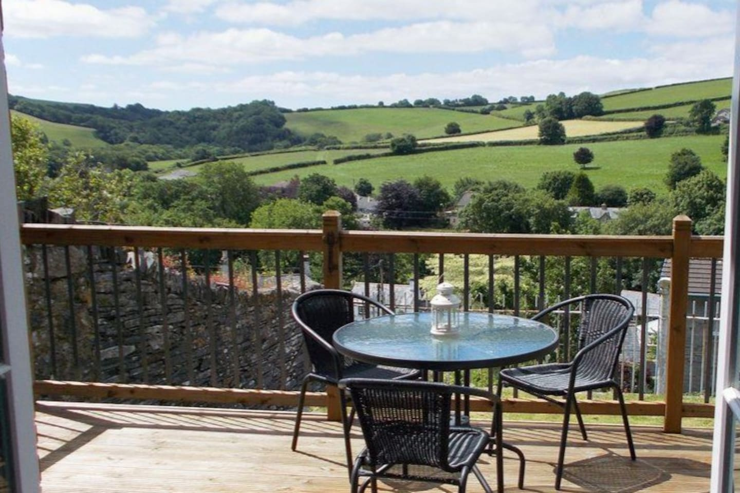 South facing decked balcony with superb 180 degree views of open farmland,  fields and woods.