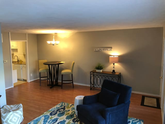 Living room and dining area from enclosed porch.