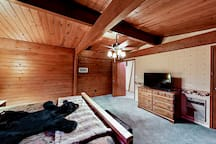"""The master bedroom offers a 43"""" flat screen TV and cozy blankets."""