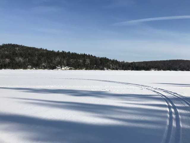 Lac des Iles in winter and skidoo tracks