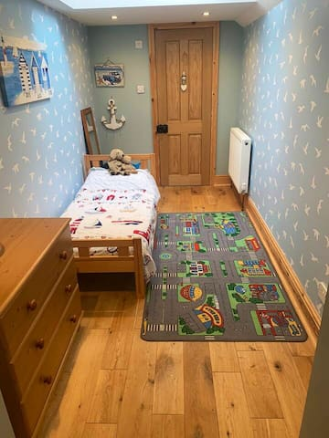 Back bedroom with toddler bed