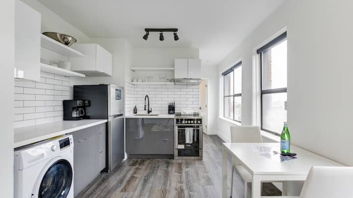 Lux studio with floor-to-ceiling tile in bathroom and kitchen
