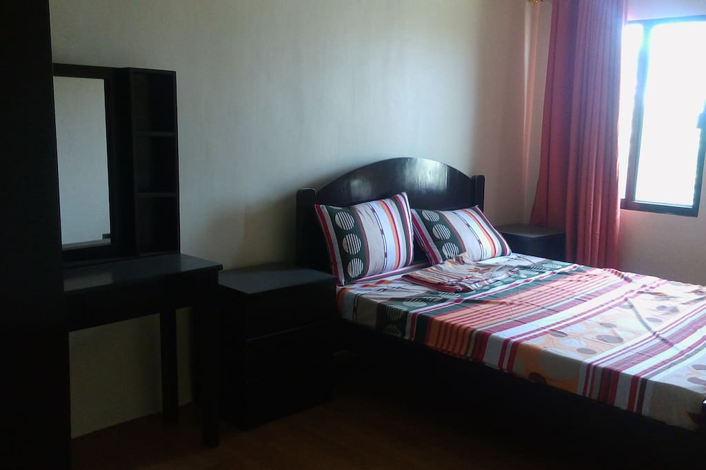 Master's Bedroom with double bed. Additional foam mattress available for additional guest. Airconditioned room.
