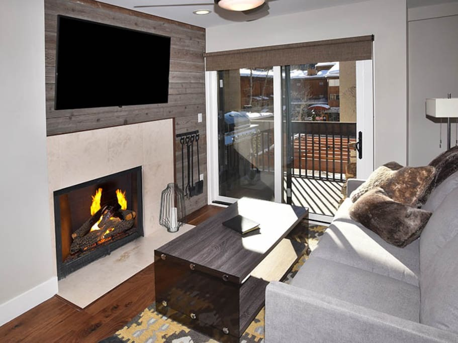 Living Room w/55 Inch TV & Wood Burning Fireplace
