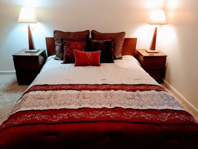 Comfortable Queen size bed, night tables lamps,quiet hunter ceiling fan, extra bedding in the closet, and solid wood locking door.