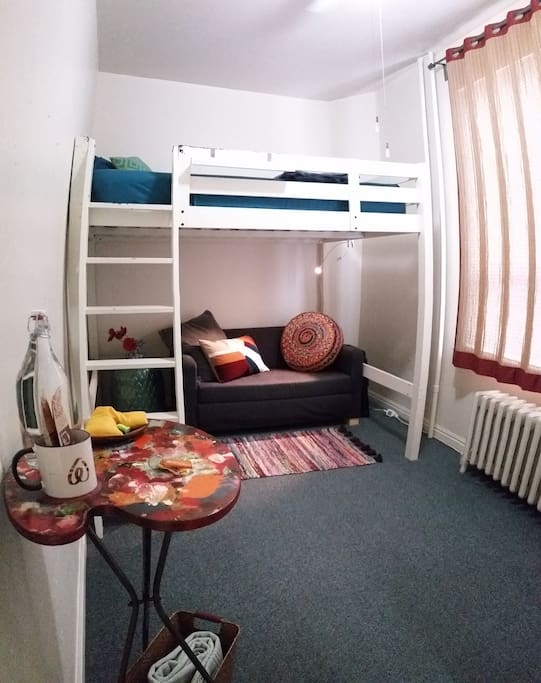 Comfortable full-size loft bed & work/lounge space (wide angle lens)