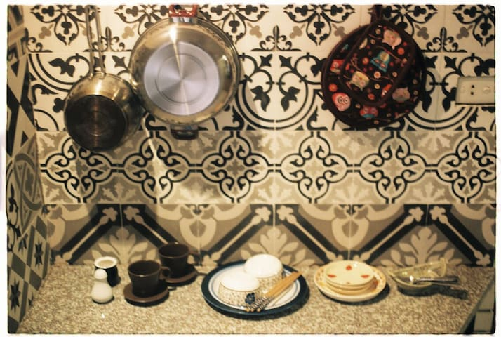 Signature floral tiles of our kitchen as legacy of 1950s French colonial influences still lingering Hanoian modern home design