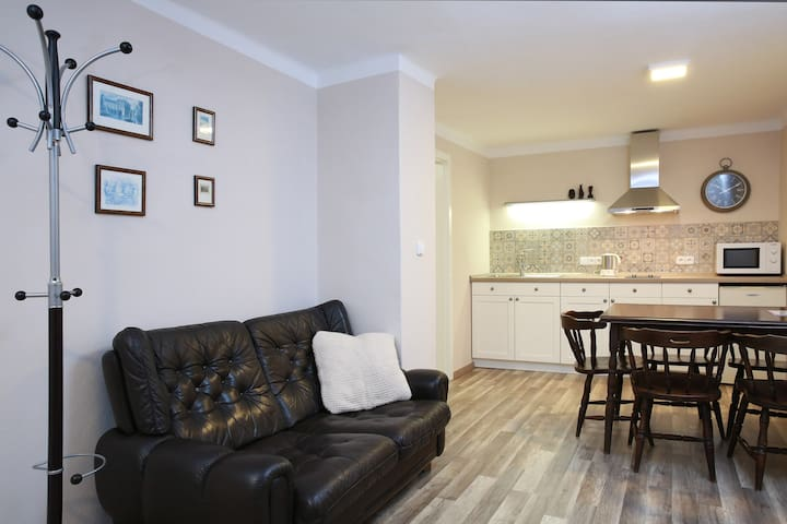 kitchen with table and sofa