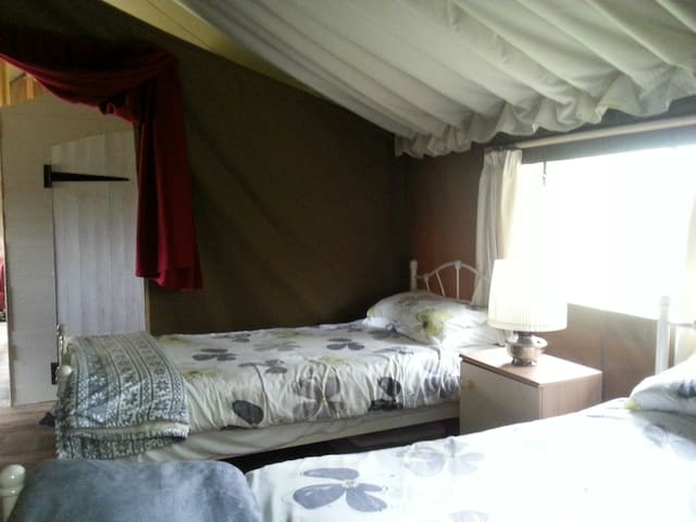 Bedroom 2 single beds, fully made up with linen, king size duvets for extra warmth