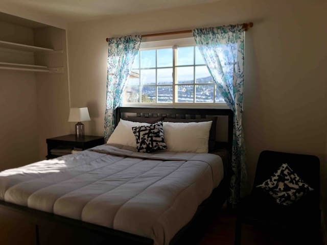Queen Bed with hilltop view