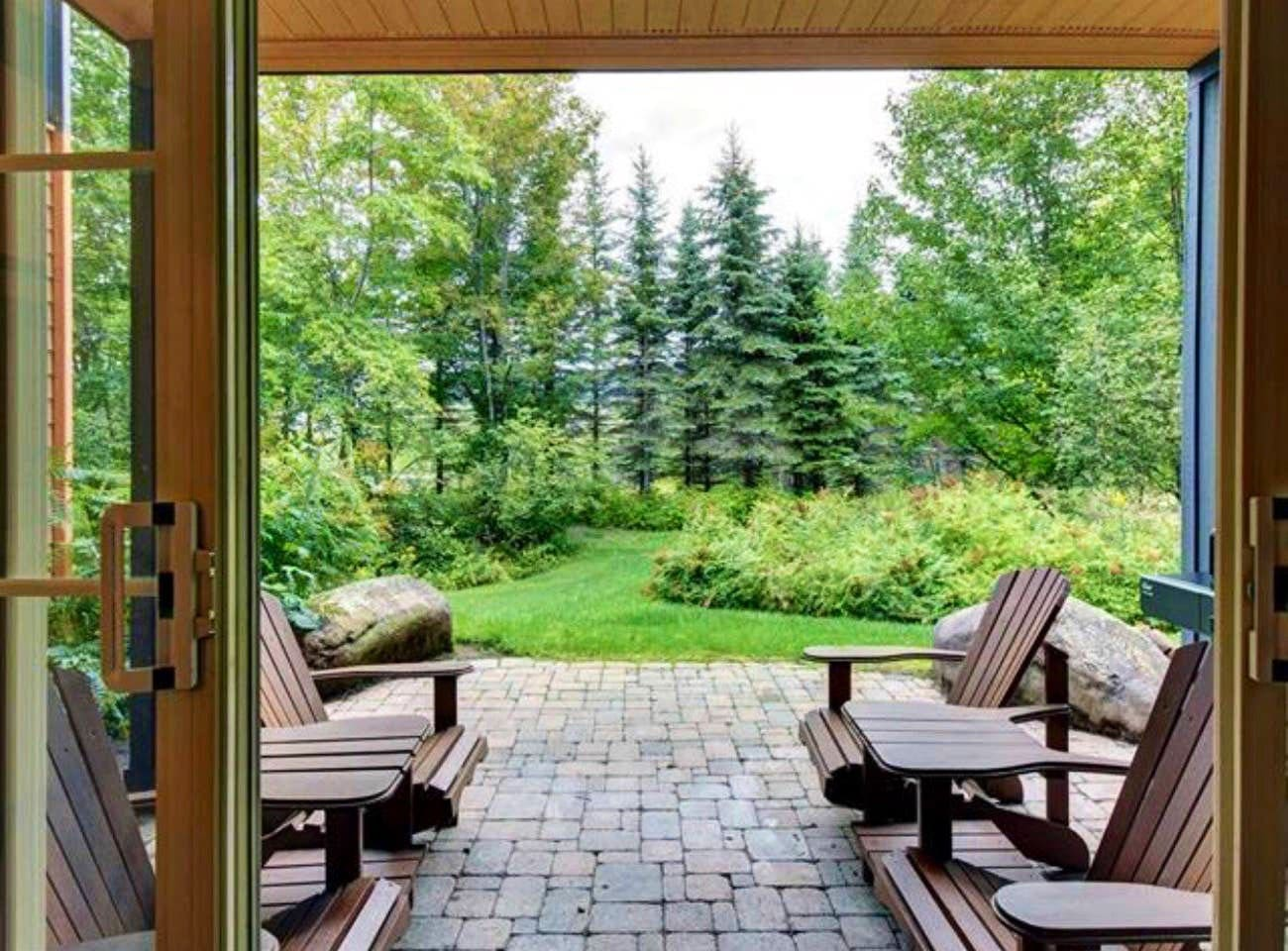 Truly a picturesque view from the living space.  nestled among trees...private & quiet & right at ski out trail. 350 m to where alternate trails meet. Whether you are walking, skiing, cycling, it's all at our doorstep!Grab your water bottle & go.